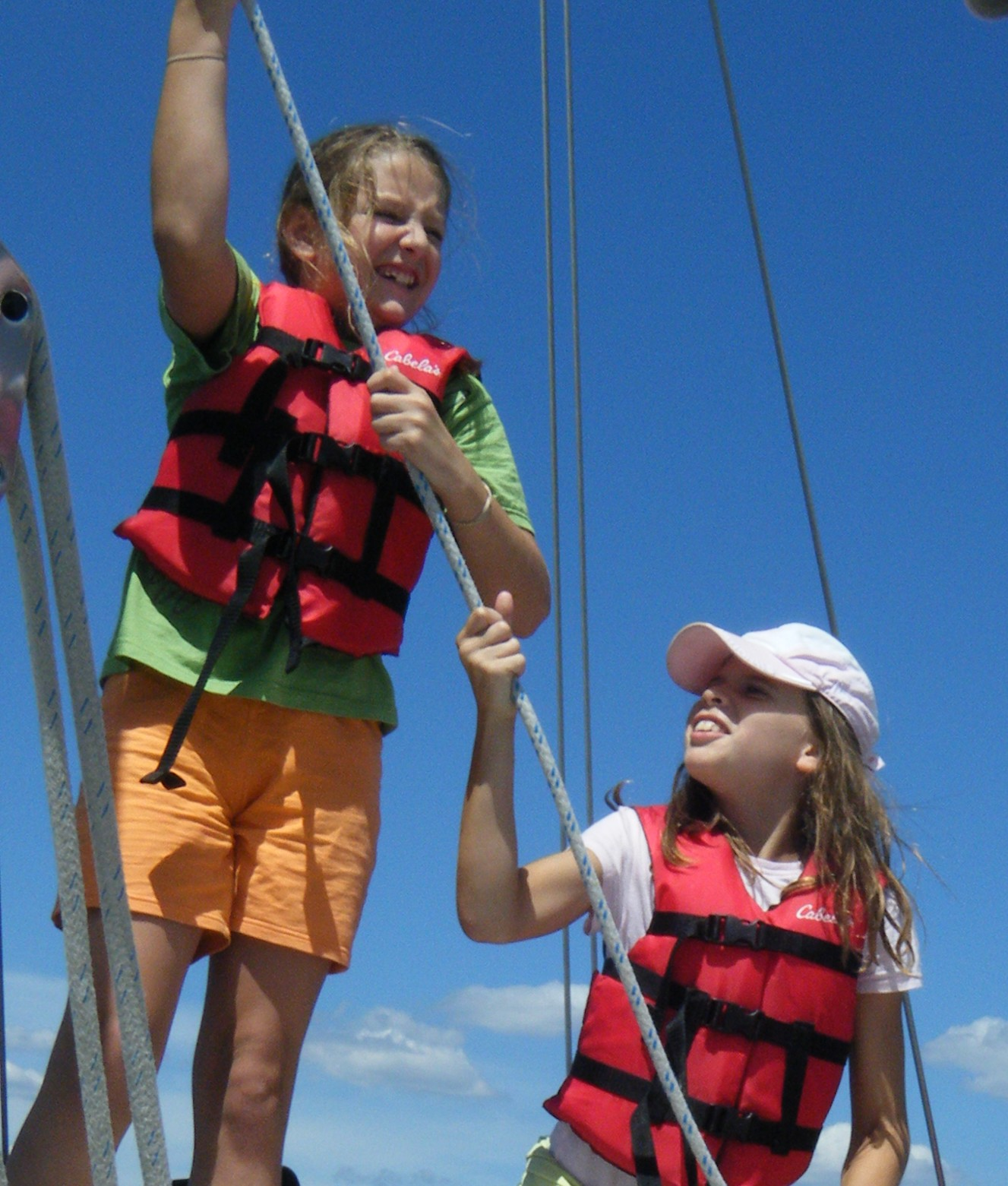 Girl Scouts Raising Sails and learning about teamwork and sailing and navigation