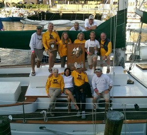 The crew and the trophies: 1st Overall, 1st over the Finish Line and 1st in Class!