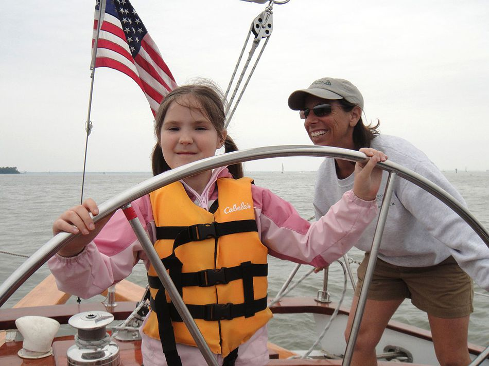 Brownies (Girl Scouts) steering the boat in Annapolis