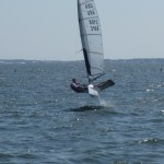 Moth Sailboat flying/sailing through the water