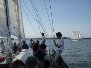 Schooner Woodwind sailing past the AJ Meerwald in Annapolis