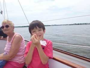Emilio showing off his newly lost tooth on the Schooner Woodwind.