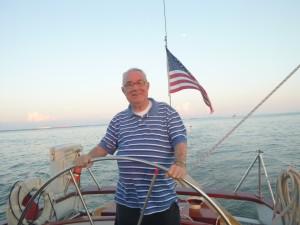 Fr. Al Olive steering Schooner Woodwind