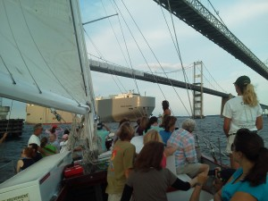 Woodwind sailing under the Chesapeake Bay Bridge while a car carrier crosses under too!