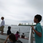 Sailing by an anchored cargo ship on the Chesapeake Bay.