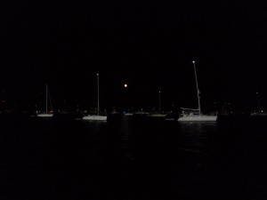 Moon rising above anchored fleet for Annapolis fireworks