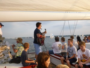 Sean Tracy singing on the Local Singer/Songwriter Cruise on Schooner Woodwind