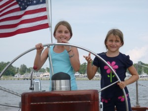 Alyssa and Natalie at the helm of Schooner Woodwind