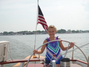 Captain Annie at the wheel of Schooner Woodwind