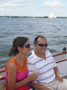 Couple drinking wine on Schooner Woodwind wine tasting cruise