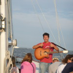 Auston Ellis sings on the Schooner Woodwind