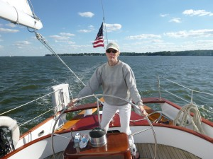 Sandra at the wheel of Schooner Woodwind