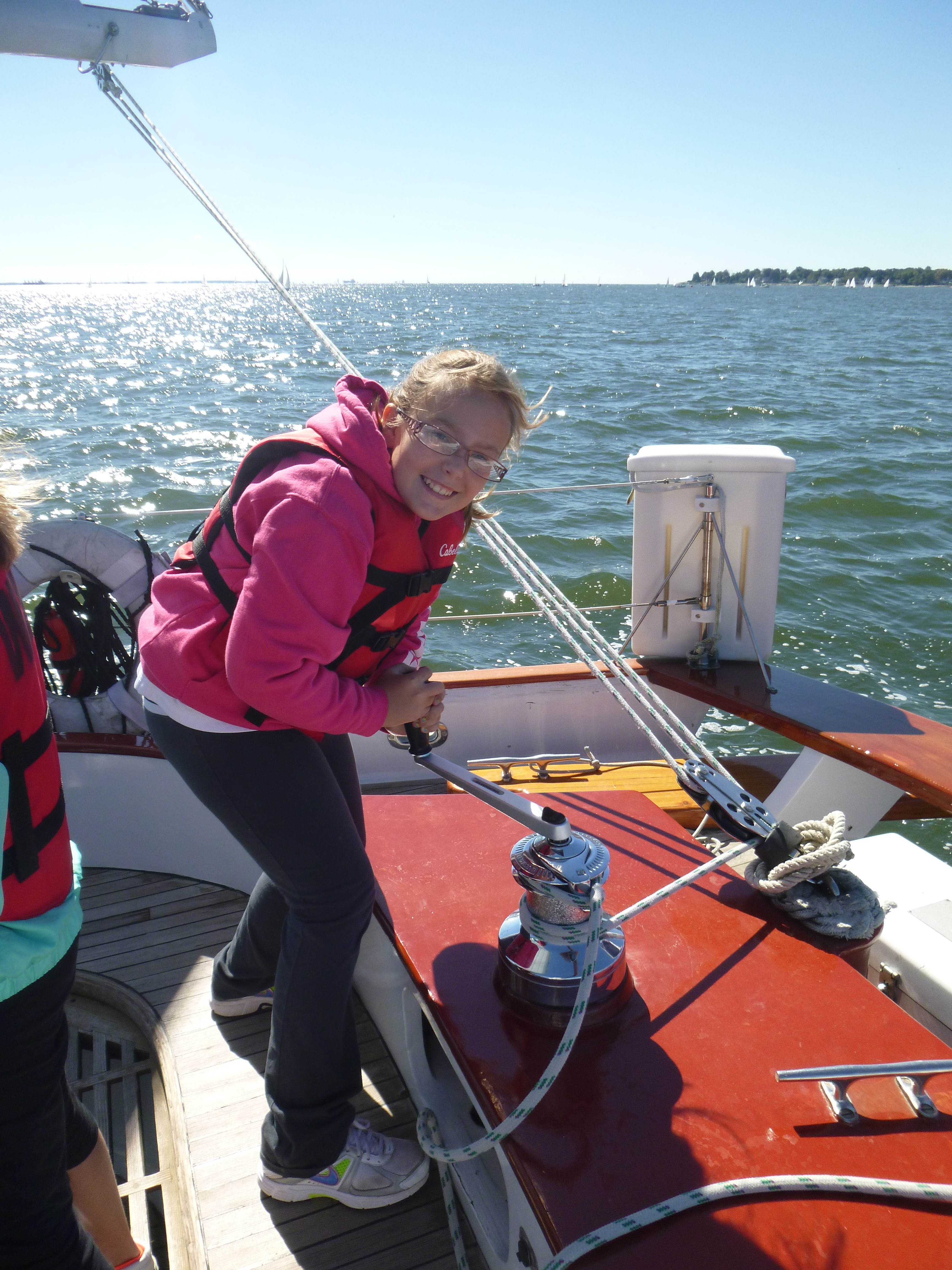 Girl Scouts learning to use the winch on the schooner