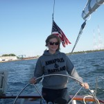 Lauren at the wheel of Schooner Woodwind