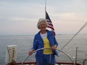 Marjorie Ackerman at the Wheel of Schooner Woodwind