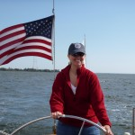 Captain Leanne on her birthday steering the Schooner Woodwind