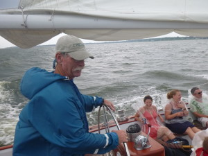 Don sailing Woowind II with a single reefed main and jib