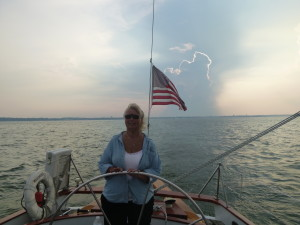 At the helm of the Woodwind! Check out the cool cloud behind her too!