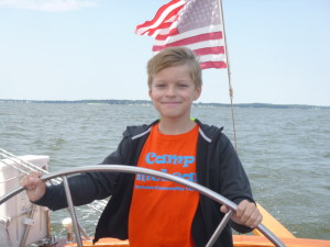 Dillon at the wheel of the 74' schooner Woodwind