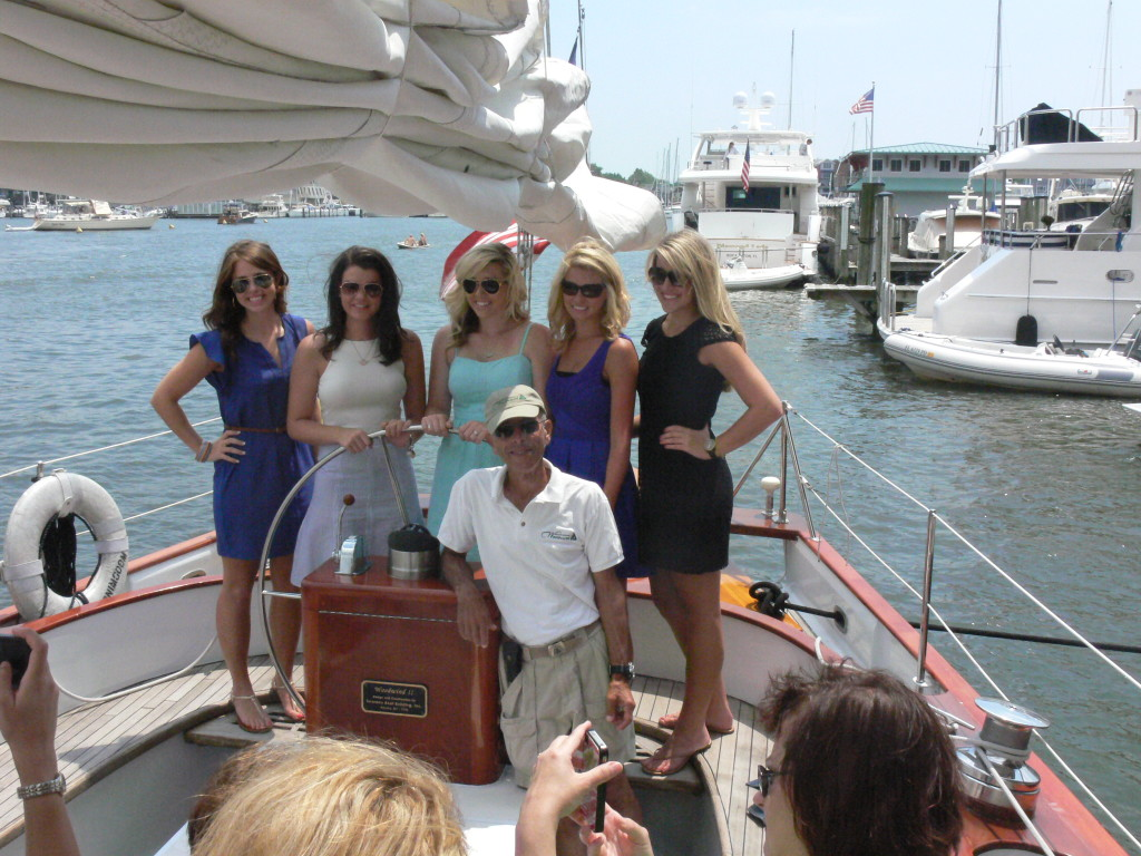 Watermelon Queens Carol, Catherine, Amber, Chelsey and Brandi pose in front of Captain Ken.
