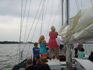 Scott's friends raising the mainsail on Schooner Woodwind