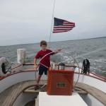 Joe at the wheel of the Schooner Woodwind