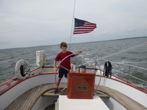 Joe at the wheel of the Schooner Woodwind