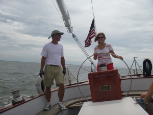 Mary at the wheel of the Schooner Woodwind II