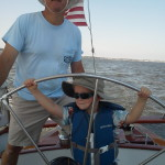Mark shows his son Nate how to sail the Schooner Woodwind. A new crew-member in the making.