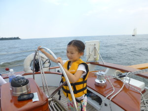 Girl Scout at the helm of Woodwind II