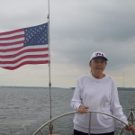 AAA Winner Carol Ann at the wheel of the Schooner Woodwind