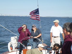 Charter guests at the wheel of Schooner Woodwind