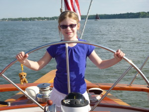 Capt. Rachel at the wheel of the Schooner Woodwind