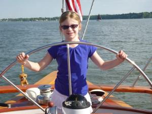 Capt. Rachel at the wheel of the Schooner Woodwind