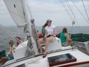 Melanie sheeting the staysail in the gusts