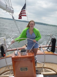 Zoe at the helm of the Schooner Woodwind II