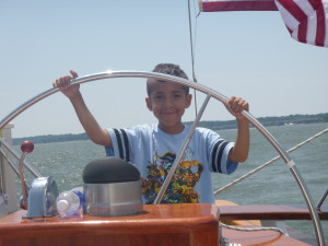 Jason at the Wheel of the Schooner Woodwind