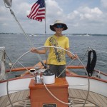 Smilin Jack! At the wheel of the Schooner Woodwind