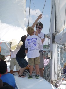 Matt's helpers for pulling up the staysail