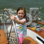 Lola, 5 years old, taking a turn at the helm