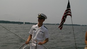 Plebe at helm