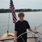 At the helm of the Schooner Woodwind