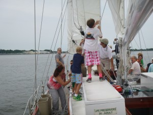 Kids helping raise the staysail