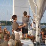 Sam's helper on the stay sail