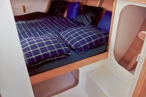 Interior guest stateroom aboard Schooner Woodwind