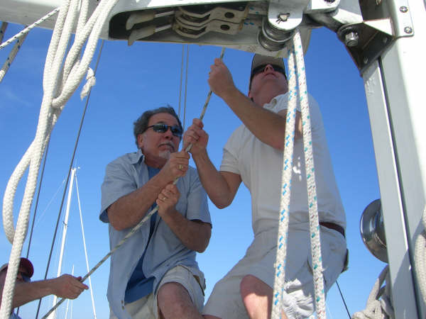 Guests raising the sails on a Team Building Group