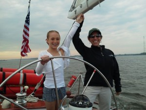 Amanda Gaskins at the helm of the Schooner Woodwind