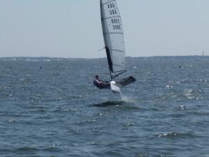 Moth Sailboat flying/sailing through the water