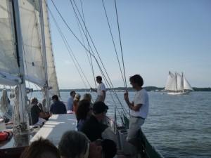 Schooner Woodwind sailing past the AJ Meerwald in Annapolis