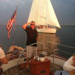 Guest Captain Baker and framed by our sister schooner behind him